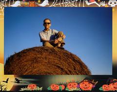 Sitting On A Bale Of Hay (Brock5604) Tags: blue autumn boy sunset sky man male guy fall film halloween field sunglasses smiling self season polaroid golden evening big high october sitting afternoon fuji photographer outdoor farm border seasonal wide straw instant hay bale rayban wayfarers instax