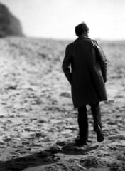 Frozen Sand (Evan Tchelepi) Tags: blackandwhite film 35mm dark sand nikon cowboy tmax highcontrast softfocus lonesome