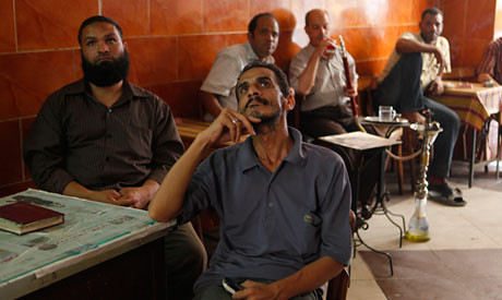 Egyptian unemployed men in coffee shop. The economy is not improving in the North African state.
