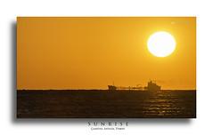 sunrise-camyuva (BoraBaysal) Tags: travel sea orange sun holiday seascape beach sunshine sunrise turkey happy golden sand ship joy antalya joyful tanker camyuva vision:sunset=0665 vision:outdoor=0799