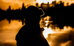 Girl on fire (Bhalalhaika) Tags: sun reflection ice silhouette oslo norway bronze reflections hair fire gold wind skating conceptual blowinghair girlonfire canon5dmarkii matsanda bhalalhaika vision:sunset=0624 vision:sky=0837 vision:dark=0506