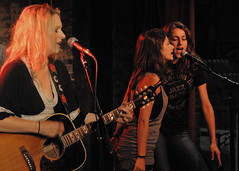 Cast members Sara Hoteit and Lama Masri sing onstage with country star Greta Gains in Nashville, Tennessee.