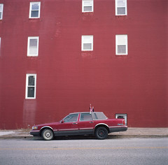 (Josh Sinn) Tags: street windows red color building 120 6x6 film mediumformat md kodak maryland baltimore lincoln parked 100 towncar yashicamat124g ektar joshsinn