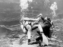 Vintage divers fighting under water (Vintage Scuba) Tags: men wet water fetish vintage us photo belt divers tank pants mask photos under scuba diving rubber double hose suit jacket beavertail aqualung jacques weight striped fins bcd weights wetsuits cousteau smoothskin sharkskin