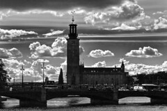 DSC_0518(B&W)aFAA (john.cote58) Tags: stockholm sweden eu europe river bridge blackwhite lamppost city water trees clouds church religion auto car traffic