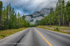 Into the Canadian Rockies (RichHaig) Tags: landscape nikonnikkor1424mmf28 mountains richhaig gitzotripod clouds banffnationalpark leadingline road banff twprd261crd sky canada lakeminnewankasenicdrive trees nikond800 alberta