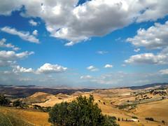Sicilian countryside (paletta_7) Tags: hills countryside clouds sky sicily siciliancoutryside summer sunshine italy enna