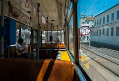 Tram line 2 (Dovhage Photography) Tags: vienna austria 2016 tram line 2 colors ottakring summer shadows traditional people viennese retro bim brown yellow light warmth spring hot woman boy dovhage schnbichler flair red seats blue sky sign architecture infrastructure transport system old