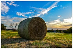 Make Hay While the Sun Shines (vainapur) Tags: sun sunlight serene serenity scenic landscape happiness haystacks hay haybales fall farm farmland farms light sunset perspective blue bluesky bright middleamerica midwest dusk nature naturespainting sky openskies open