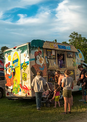 Summer Eves (iAM Peterson) Tags: festival fair carnival ice shavedice vendor colorful foodcart family children summer hot sunset warmth celebrate bazaar eating fuji xe1 color