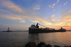 Departing at Sunrise (GLC 392) Tags: llt lower lakes towing saginaw grand river navigation ludington mi michigan lighthouse sun rise sunrise clouds lake water sky amazing life