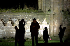 Figures at Fountains Abbey at night (Tony Worrall) Tags: yorkshirephotos east eastern northyorkshire yorks yorkshire relic abbey ruins stone built building ruined historic past pastime england unitedkingdom northern uk update place location north visit area county attraction open stream tour country fountainsabbey night floodlit lights shadows lit