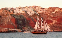 waiting for sunset (lesleydugmore) Tags: sea ship boat water oia santorini greece cyclands greekisland sunset red port rock sails building trip steps windmill cars cruise