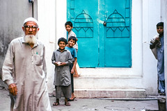 In a narrow alley, Walled City of Lahore, Pakistan (travelingmipo) Tags: travel photo film pakistan     pakistani lahore   people walledcityoflahore oldcity   street alley door offstreet kids