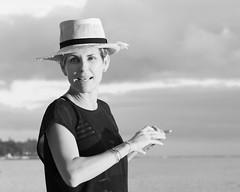 Fedora (Oliver Leveritt) Tags: nikond7100 afsvrzoomnikkor70300mmf4556gifed oliverleverittphotography waikikibeach waikiki honolulu hawaii oahu woman candid monochrome blackandwhite hat fedora