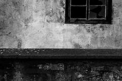 Detail 159 (Isengardt) Tags: 159 detail fenster window mauer wall wand putz fassade broken kaputt destroyed zerschlagen bruch black white schwarz weiss monochrome monochrom bw sw composition komposition dunkel dster dark esslingen badenwrttemberg deutschland germany europe europa olympus omd em1 1250mm haus house abandoned lostplace lost place