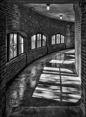 Ellis Island Ferry Building (johnredin) Tags: bw ellisisland hdr newyork abandoned architecture cities doorswindows shadows