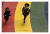 Les jeux d'enfants (hélène chantemerle) Tags: enfants photosderue sol fillettes courir couleurs arcenciel rouge jaune vert bleu children kids running rainbow colors red yellow green blue laughing