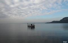 lentamente ...scivolare... (Betti52) Tags: lago di garda barca nuvole riflessi
