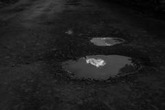 DSCF6624 (Galo Naranjo) Tags: pothole hueco cloud nube
