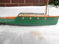 HORNBY VIKING windup tin pond yacht (oldsailro) Tags: park old boy sea summer people sun lake playing beach water pool girl sunshine youth sailboat race vintage children fun toy tin boat miniature wooden pond model waves sailing ship child time yacht antique group boom regatta mast hull spectators windup viking watercraft hornby adolescence keel fashioned