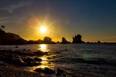 Ocaso (Emilio Rodrguez lvarez) Tags: ocean espaa costa mer sol beach nature water azul contraluz landscape atardecer iso100 mar agua rocks f14 natur asturias playa paisaje panoramic highlights arena cielo nube
