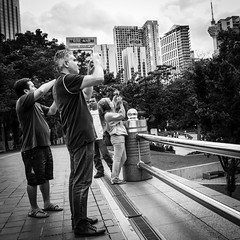 Synchronized Snappers (Itchyklikfinger) Tags: city people urban blackandwhite streetphotography malaysia kualalumpur 2013 canon70d
