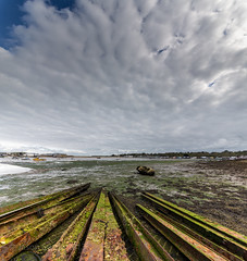 """The Disintegrated Feeling (s0ulsurfing) Tags: s0ulsurfing 2013 october autumn isleofwight isle wight island sigma1224 12mm 6d wide wideangle sky skies cloud clouds patterns weather composition england english nature natural scenery britain british nephology meteorology nube bembridge bembridgeharbour""""skyscapecloud porn""""eastwight girders rust rusted decay lines"""