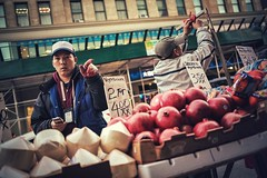 BUY MY POMEGRANATE!!! (Neo - nimajus) Tags: newyorkcity portrait people ny newyork streets fruit canon downtown chinatown manhattan streetphotography pomegranate 5d empirestatebuilding empirestate newyorkstate fruitstand mark3 markiii 5d3 5diii