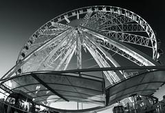 Brighton Wheel (grahambrown1965) Tags: blackandwhite sun sunlight white black wheel booth star sussex brighton pentax ticket fisheye starburst ticketbooth 1017mm smcpentaxda1017mmf3545ediffisheyezoom justpentax pentaxart brightonwheel k5iis
