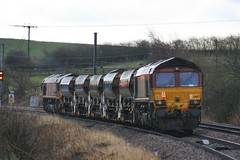 T&T Sheds.  0830 Milner Royd Jn to Doncaster Up Decoy (Yorkie Fatboy) Tags: class66 ews
