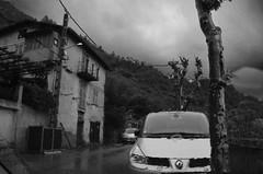 La Grande Peur dans la Montagne (4) (Jean-Luc Lopoldi) Tags: bw wet rain clouds dark village noiretblanc pluie voiture nuages windscreen threat orage vitre parebrise mouill cielmenaant