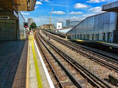 Wood Lane tube station (Martin Carey) Tags: sky london clouds crane platform tracks samsung railway tubestation londonunderground redlight yellowline londontransport woodlane thirdrail samsunggt19300 june122014
