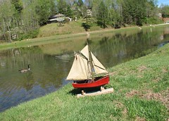 Vintage pond yacht (oldsailro) Tags: park old boy sea summer people sun lake playing beach water pool girl sunshine youth sailboat race vintage children fun toy boat miniature wooden pond model waves sailing ship time yacht antique group boom mast hull keel