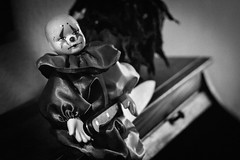 Clown on the Shelf (DarlingJack) Tags: clown creepy creepyclown knife horror doll clowndoll puppet toy blackandwhite evil porcelaindoll killertoy killerdoll scary stab twilightzone livingdoll