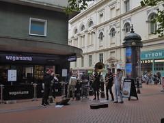 Busking in Birmingham (metrogogo) Tags: sousaphones trombone trumpet saxophone drums symbols 7pieceband septet buskers musicians players wagamama byron burgers busking birmingham