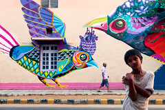 Street Art. New Delhi, India. (Marji Lang Photography) Tags: delhi delhistreets india indian lodhi lodhicolony newdelhi art artist artistic birds boy color colorful colors horizontal kid man mood multicolor northernindia paintedwall painting street streetart streetartist streetphotography streetscene streetstyle twopersons urbanscene wallpainting fresque people moody
