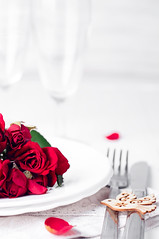 Festive table setting with beige roses, wine glasses, napkins and cutlery, (lyule4ik) Tags: table setting dining celebration decor template ready beige dinner lights banquet arrangement roses fork decoration meal nobody silverware reception color wedding elegance linen ornate romance party indoors china glass photography isolated plate white flower holiday restaurant luxury dishware event napkin place bouquet crystal catering candle wineglass textile text space special