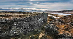 Icelandic Wildnerness (www.theaperturegeek.com) Tags: thingvellir national park iceland icelandic travel adventure sky outdoors clouds sun blue clear daytime rocks grass horizon canon 70d sigma 1770 moss tundra northernhemisphere snow peakes mountain mountains range cold frost travelphotography