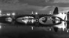 Do bridges sleep by night? (lunaryuna) Tags: england london hamptoncourt hamptoncourtbridge architecture riverthames night nocturnal nightphotography nightlights le longexposure reflection mirrored seeingdouble blackwhite bw monochrome urban urbanconstructs walkinthecity luanaryuna bridge arches lanterns