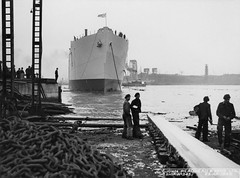 Launch of the cargo ship 'Empire Fawley' (Tyne & Wear Archives & Museums) Tags: southshields shipbuilding johnreadheadsonsltd cargoship shipyard shiplaunches workers vessel rivertyne launch empirefawley tugboat rivers water historic northeastengland tyneside maritime industry industrial ships secondworldwar ww2