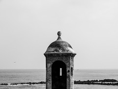 Watching pirates (1jonathan1) Tags: blackandwhite blancoynegro sky skyline caribbean sea architecture rocks sun light ocean seascape cartagena cartagenadeindias city walls pirates
