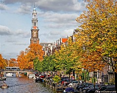 View of the elaborate Westerkerk clock tower and steeple (PhotosToArtByMike) Tags: herengracht amsterdam westerkerk clocktower herengrachtcanal netherlands canalring grachtengordel bikes dutch holland canalboat houseboat canal canalhouse
