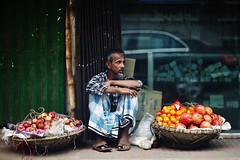 What's wrong with my fruits ? (N A Y E E M) Tags: seller vendor hawker fruits candid portrait today afternoon footpath pavement street ashkardighirpar chittagong bangladesh carwindow reflection car colors