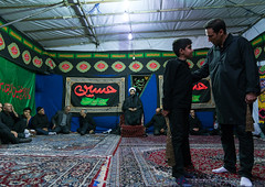 Iranian shiite muslim men listening to a mullah who preaches during muharram, Central county, Theran, Iran (Eric Lafforgue) Tags: 9people adults ashura ceremony child colorimage commemorate faith fulllength groupofpeople horizontal hosseinieh hussain imamhussein indoors iran iranian iranianculture islam men menonly middleeast mourning muharram muslim people persia pray prayer praying religion remembrance ritual script shia shiism shiite spirituality tehran tradition worship worshiping theran centralcounty