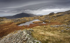Llygad y Storm / Eye of the Storm (Ffotograffiaeth Dylan Arnold Photography) Tags: landscape eryri storm snowdonia penyrolewen ogwen devilskitchen nationalpark mountains clouds cloudformations grass lake island rock rocks secluded lonely barren remote water reflection marsh bog weather outdoor isolated desolate tranquil peaceful northwales uk mountainous asperitas asparatus cloud