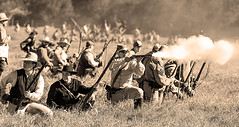 Skirmish Line (wyojones) Tags: texas hempstead liendoplantation civilwar reenactment civilwarweekend southern rebel texan uniform confederatesoldier rifleman man boy handsome soldier hat infantry rifle gun fire smoke powder sepia wyojones
