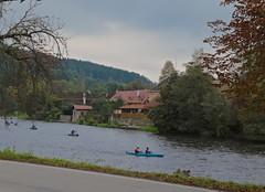 Race Day on the Vltava River 02 (smilla4) Tags: paddling boats race vltavariver moldau houses sky clouds czechrepublic autumn foliage rozmberknadvltavou
