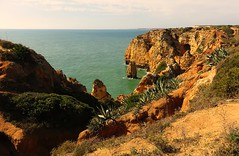 Cliffs (Gert Vanhaecht) Tags: portugal algarve waterreflections gertvanhaecht coast sea reflections waterreflection availablelight canonpowershotsx700hs color lagos cliffs nature orange water canon colour landscape ocean light green reflection clouds