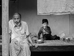 grand_father (AVRO RAHMAN) Tags: people village bangladesh grandchild grandfather child age stage avro canon pointshot great bw black white moment